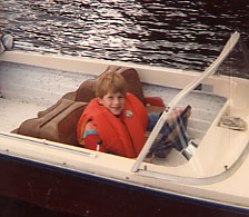 Christopher Horrel as a young man, in a boat